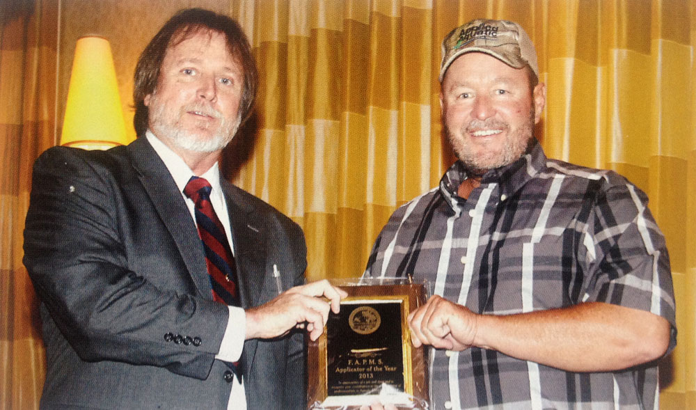 President Tim Harris presents the award to Mr. Tracy Wood